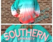 Preppy, Trendy, Cute, AND ON SALE Spirit Jersey Tee. Southern Dynasty.  Unisex Fit.  Comfy and Cozy.  Teal, White, Coral Blend Color.