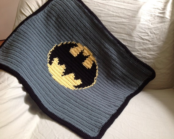 A lovely custom made Baby Blanket using Batman cotton fabric on the front with a Navy Blue'Minky' Dimpled Plush Fleece fabric on the back. Fully washable .