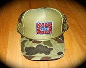 Camo trucker fly fishing hat by Jonathan Marquardt of BadAxeDesign