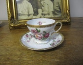 Beautiful fine Bone China Footed Tea Cup and Saucer Made in Japan. ROSIE