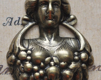 Victorian lady brass stamping with basket, oxidized brass