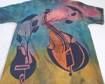 Man's large discharge t-shirt with procion dyes, abstract guitars,double bass, and mandolin with tree limbs &birds, orange, pink,blue, green