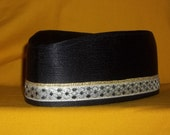Hand Made Black Krinkle Satin with gold and black band. Custom Designed in African Military Style