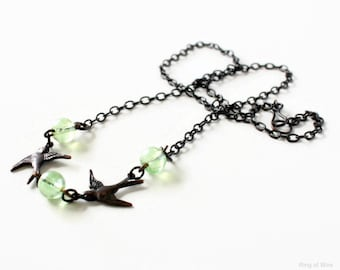 Bird Charm Necklace, Black Cable Chain Necklace, Black Bird Necklace, Green Glass Bead Necklace, Minimalist Necklace, Swallow Charm Necklace