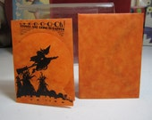 Unused die cut 1920's-30's halloween party invitation and envelope orange parchment paper with image of witch on broom flying over haystacks