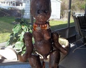 Twisted fertility doll on doll stand