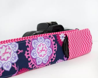 DSLR camera strap cover with lens cap pocket.  Pink ribbon and chevron.