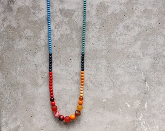 Long colour block necklace, wooden bead necklace, blue, red, navy blue, orange, contemporary, fashion.