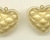Two beautiful vintage lucite pillowy heart pendant beads - filled with shimmering gold - 33 mm