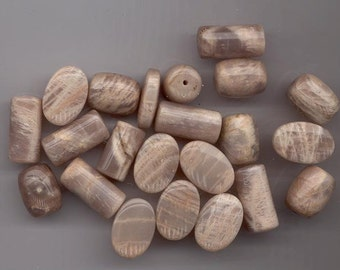 22 lovely pinkish beige sunstone beads in three shapes: cylinders, barrels, and flat ovals