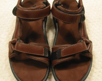 """vintage womens dark brown """"Pretty Rugged Leather""""  sport sandals by TEVA . . . .  size 5 . . .new in box"""