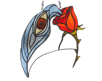 stained glass suncatcher of a rose crow and eye