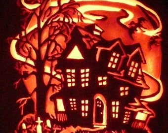 Haunted House hand carved on a foam pumpkin
