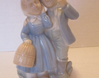 Vintage boy and girl ceramic figurine no markings