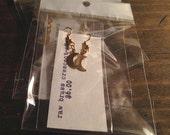 raw brass crescent moon dangle earrings