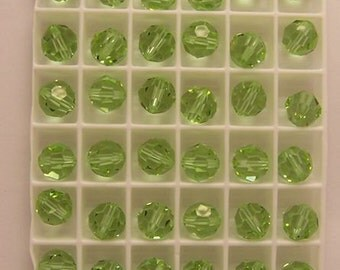 Swarovski - Cantalope (#5000) faceted round - 8mm - 36 beads (1/4 gross)