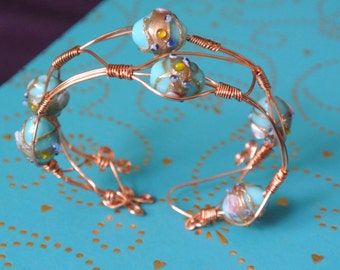 Copper Wire Bracelet, Hand wrapped Glass beads, blue with copper overlay