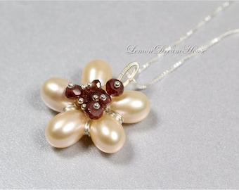 June Birthstone. Pearl Flower Necklace, Freshwater Pearls, Peach Top Drilled Rice, Mozambique Garnet Rondelles, Sterling Silver Chain. N191.