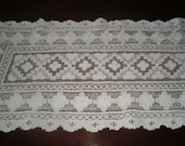 Decorative lacy runner.