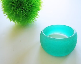 Migeon & Migeon hand carved assymetrical resin bangle--signed