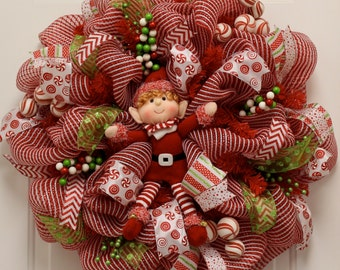 Red and white Christmas wreath with a Playful Elf