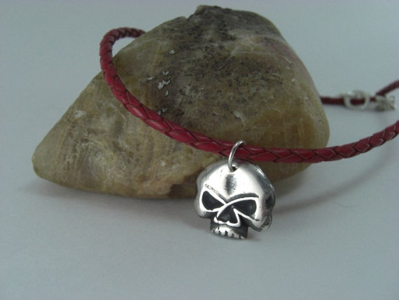 Skull pendant on leather cord PMC 3 999 pure silver