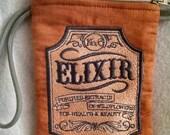 Burnt Orange Elixir Wristlet