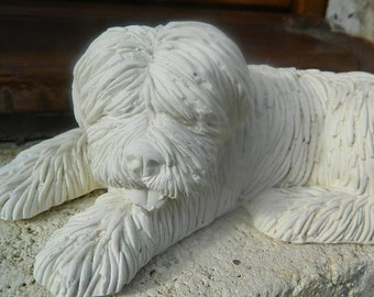 Dog sculpture on plaster