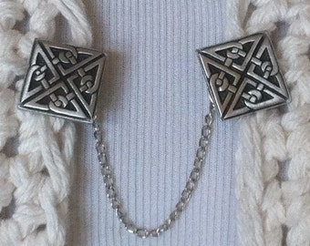 The mattie pewter Celtic knot square sweater clip adds a touch of interest to your cover ups.