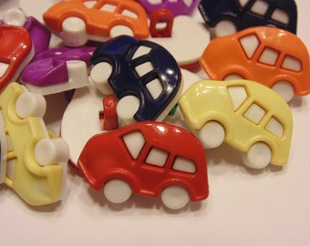 4 large assorted car buttons, 16 x 25 mm (45)
