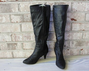Vintage black Saks Fifth Ave leather tall boots with heel size 6