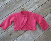 Hand knit baby girl cardigan sweater with ruffles in pink with button 6-12 months READY TO SHIP