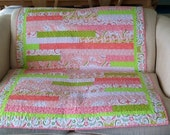 Pink,white and green lap quilt