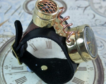 Steampunk wrist device, steampunk, brass mounted, black leather cuff, gizmo, detector