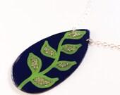 green glitter leaves on navy