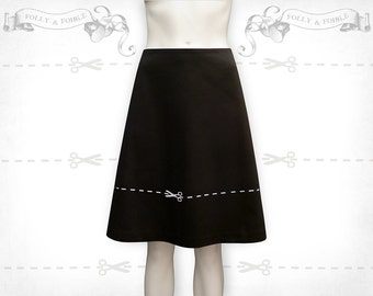 Cut across the dotted line screenprinted cotton A-line skirt Black