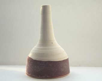 Abstract chunky small earthenware ceramic bottle with red glaze, hand thrown