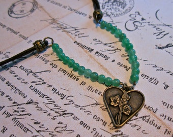 """Earthy Beaded Leather Charm Necklace """"Heart of the Forest"""" Dark Brown Cord Antiqued Brass Heart Round Jade Green Stones"""