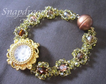 Decadent gold beaded bracelet watch with magnetic closure