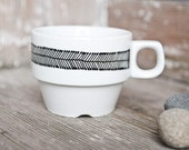"Hand-painted vintage tea cup ""somewhat angular"", black and white"