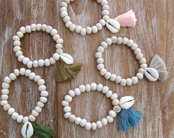 Driftwood Cowrie Bracelet, Wooden Beaded with a Cowrie Shell and Cotton Tassel