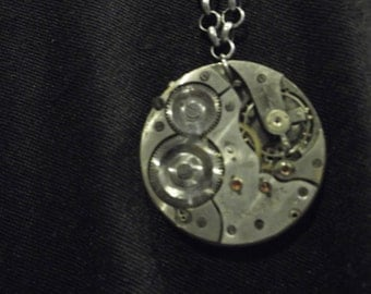 Steampunk style gunmetal chain necklace with large watch movement pendant