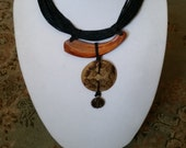 Chunky Fabulous skinny leather strands with bone and shell pendant-choker style