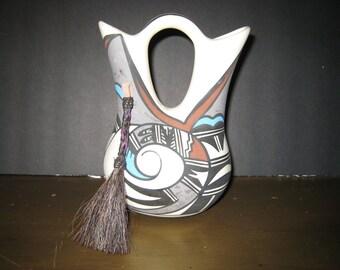 Porcelain pottery vessel by Desert Pueblo Pottery Phoenix Arizona.