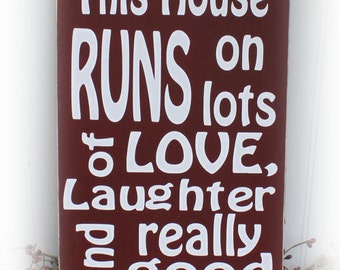This House Runs On Lots Of Love, Laughter and Really Good Wine Wood Sign