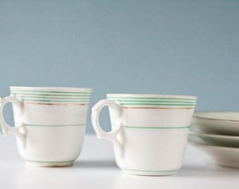 2 french porcelain cups green and white striped - 3 porcelain saucers - Napoleon  - 1800