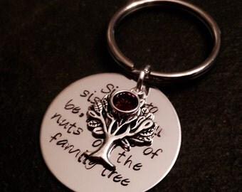 Sister and sister we will be, a couple of nuts off the family tree hand stamped keychain