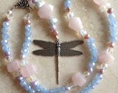 Prayer Bead Chaplet mala bead made of rose quartz, pink and lavender pearls and faceted blue glass with the symbol of a Dragonfly.