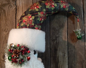 Santa Moon door wreath or wall hanging with a plush beard, sparkly floral decorations, quiilted hat material with dangle at the tip of hat.
