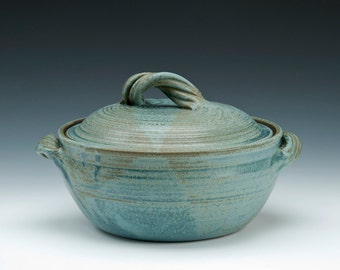 Lidded Pottery Casserole Dish with twisted strap handle